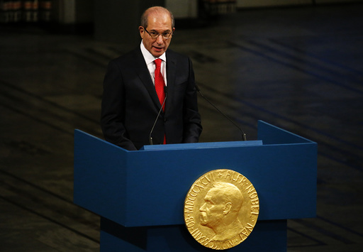 Uzumcu, director general of the OPCW delivers a speech during the Nobel Peace Prize awards ceremony at the City Hall in Oslo