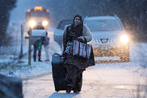 A woman walks towards the border to cross at the U.S.-Canada border after arriving in a taxi with a group that claimed to be from Syria into Hemmingford