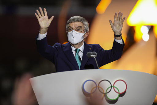 International Olympic Committee's President Thomas Bach waves during the closing ceremony in the Olympic Stadium at the 2020 Summer Olympics, Sunday, Aug. 8, 2021, in Tokyo, Japan. (Dan Mullen/Pool Photo via AP))