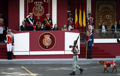 A goat, the mascot of Spanish legionnaires, parades past Spanish King Felipe, Spanish Queen Letizia and their daughters Princess Leonor and Princess Sofia during a military parade marking Spain's National Day in Madrid