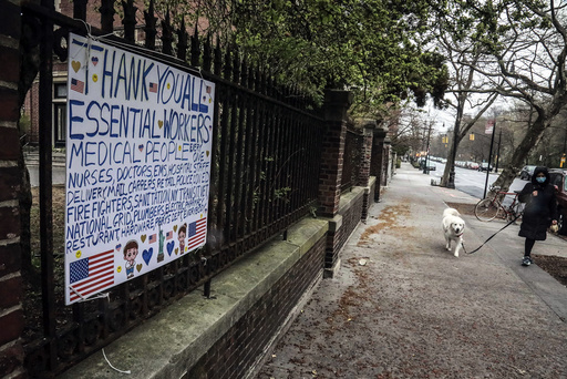 "A sign hangs from a fence thanking ""essential workers"" who continue to work while others abide by stay-at-home requirements in an effort to curb the COVID-19 outbreak, Saturday April 4, 2020, in the Brooklyn borough of New York. (AP Photo/Bebeto Matthews)"