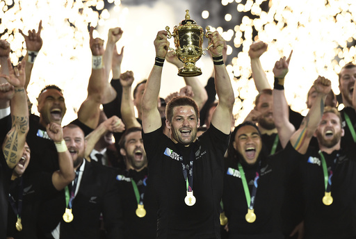 Richie McCaw of New Zealand holds up the Webb Ellis Cup after winning the Rugby World Cup Final against Australia at Twickenham in London