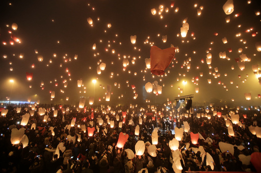 Participants release sky lanterns during the Christmas light of wishes event in Zagreb