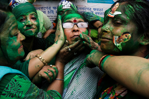 Supporters of TMC celebrate after learning the initial poll results of the West Bengal Assembly elections, in Kolkata