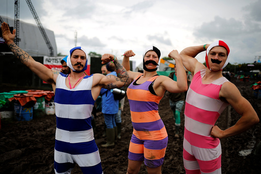 Revellers pose for a picture at Worthy Farm in Somerset during the Glastonbury Festival