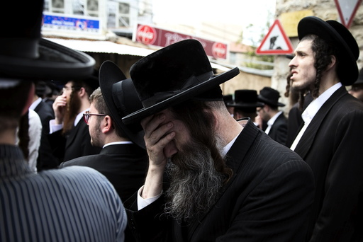 An Ultra-Orthodox Jewish man mourns during the funeral of Yeshayahu Krishevsky in Jerusalem's Mea Shearim neighbourhood