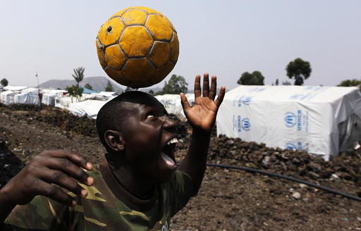 A Congolese boy displaced by recent fighting in North Kivu, juggles a ball near his makeshift shelter at the Mugunga III camp for internally displaced people near Goma