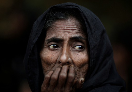 Mohol, a Rohingya refugee waits to get herself registered for humanitarian aid at Kutupalong refugee camp near Cox's Bazar