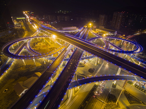 Overpass lighted in blue is seen during a hazy day in Jinan