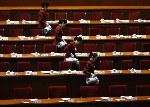 Attendants prepare tea inside the Great Hall of the People ahead of the second plenary session of the National People's Congress in Beijing