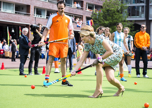 Queen Maxima of the Netherlands participates in a game of hockey during the first King's Day in Amstelveen