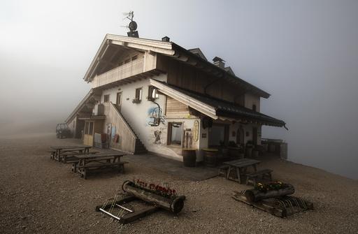 The Rifugio Averau is seen shrouded in fog near Cortina d' Ampezzo in northern Italy
