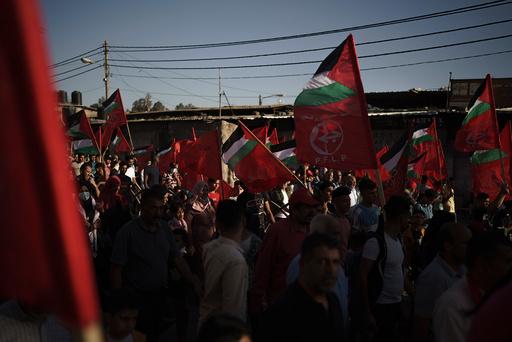 Palestinere deltar på en demonstrasjon i regi av PFLP i Gaza i sommer. Israels forsvarsdepartement terrorstempler seks menneskerettsgrupper som anklages for å ha hemmelige bånd til den militante palestinske bevegelsen PFLP. Arkivfoto: Felipe Dana / AP / NTB