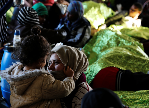 Migrants rest on the Malta-based NGO Migrant Offshore Aid Station (MOAS) ship Phoenix, a few days after being rescued in the central Mediterranean off the Libyan coast, as the ship makes its way towards the Italian island of Sicily