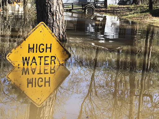 A high water sign is submerged near Lake Bistineau in Webster Parish Louisiana