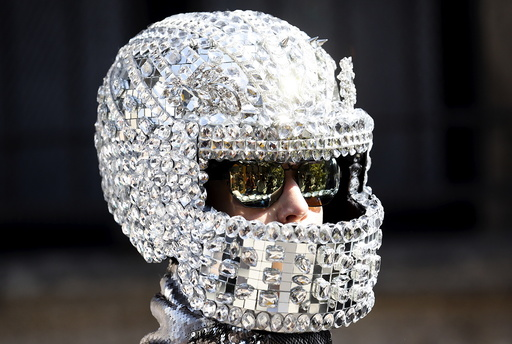 A person wears an helmet as advertising creation during the Spring/Summer 2016 collections at the Milan Fashion Week