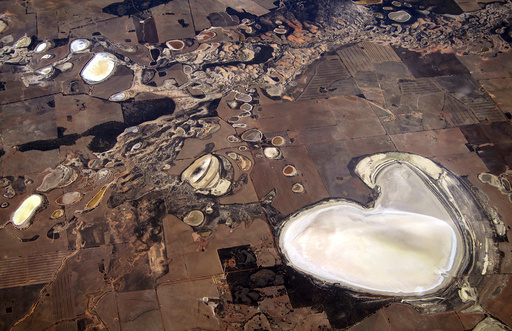 Salt pans and small dams can be seen in drought-effected farming areas located on the outskirts of the Western Australian capital city of Perth