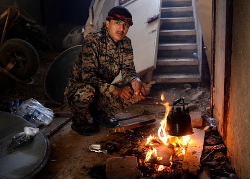A Syrian Democratic Forces (SDF) fighter prepares tea in house in Raqqa