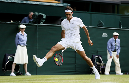 Roger Federer of Switzerland hits a shot through his legs during his match against Sam Querrey of the U.S.A. at the Wimbledon Tennis Championships in London