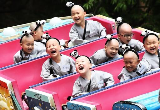 Child monks at an amusement park south of Seoul