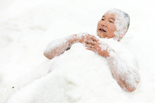 A man takes part in a cold enduring competition in Changsha