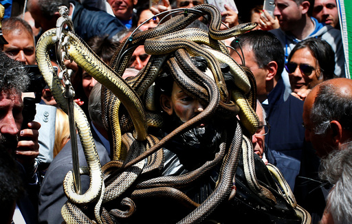 Snakes cover a wooden statue of Saint Domenico during a procession in Cocullo