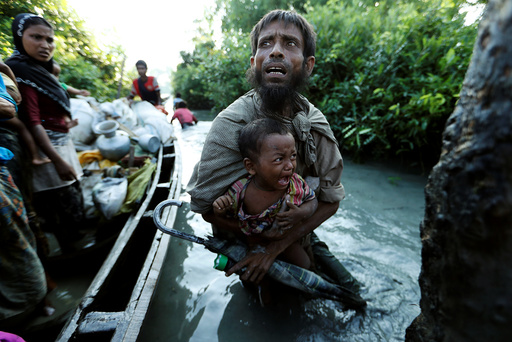 Rohingya refugees arrive to the Bangladeshi side of the Naf river after crossing the border from Myanmar, in Palang Khali