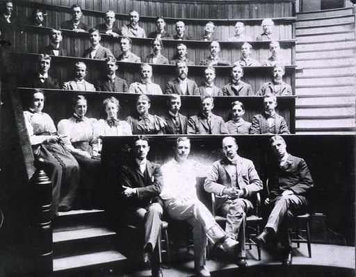Professors Harvey Cushing, Howard Kelly, Sir William Osler, and William S. Thayer (front row) sit wi