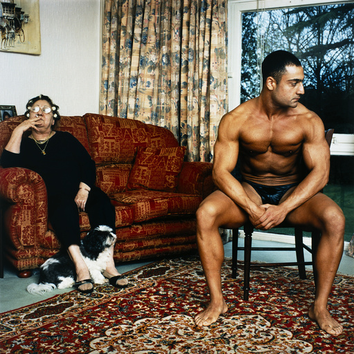 Body builder and mother at home