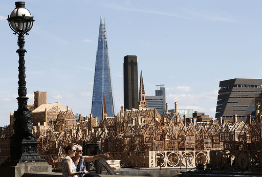 A 120-metre long sculpture of a 17th-century London skyline is completed for an event where it will be set alight re-telling the story of the 1666 Great Fire of London