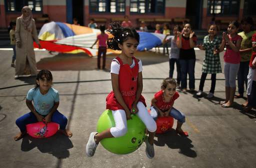 Palestinian girls play during U.N.-run summer fun games week in Gaza City