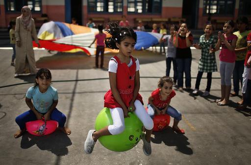 Palestinian girls play during U.N.-run summer fun games week in Gaza City
