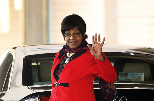 Winnie Mandela, ex-wife of former South African President Nelson Mandela, waves as she leaves the hospital where he is being treated in Pretoria
