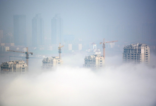Buildings under construction are seen during a hazy day in Rizhao