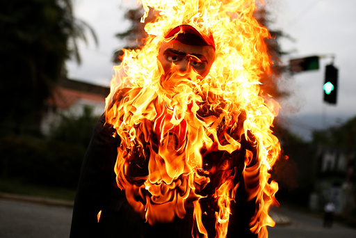 An effigy depicting Venezuela's President Nicolas Maduro is set alight during the traditional burning of Judas as part of Holy Week celebrations, at a street in Caracas