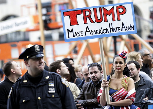 People take part in an anti-Donald Trump, pro-immigration protest outside the Plaza Hotel, where U.S. Republican presidential candidate Donald Trump spoke, in the Manhattan borough of New York