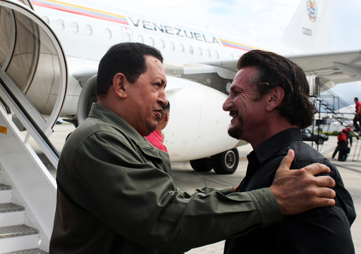 Venezuela's President Chavez talks with US actor and director Sean Penn in Cumana
