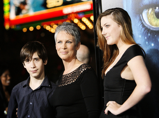 Actress Curtis poses with her children Thomas and Annie at the premiere of