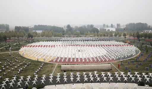 Participants practice Taichi on a square during a Guinness World Record attempt of the largest martial arts display, on a hazy day in Jiaozuo