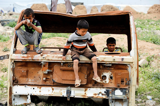 Displaced Iraqi children who fled their homes with their families play outside Hammam al-Alil camp south of Mosul