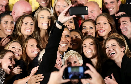 U.S. President Barack Obama poses for a selfie with US women's soccer team at the White House in Washington