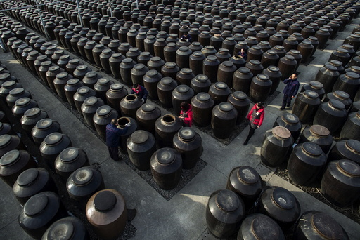 Employees work at a vinegar mill in Zhenjiang