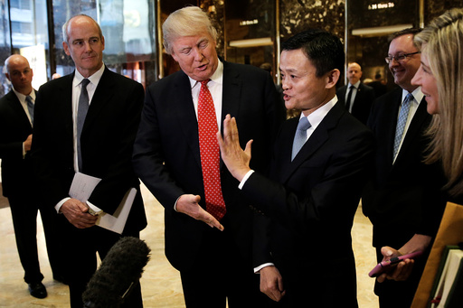 U.S. President-elect Donald Trump and Alibaba Executive Chairman Jack Ma speak with members of the news media after their meeting at Trump Tower in New York, U.S.