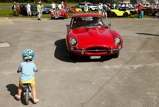 Participants arrive in their vintage Jaguar E-Type sports car during the British Car Meeting 2016 in Mollis