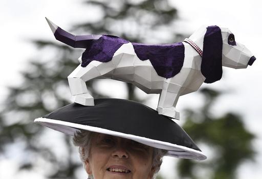 Britain Horse Racing Ladies Day Racegoer wears hat