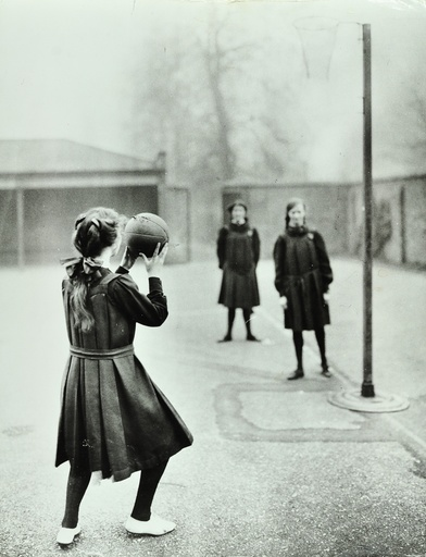 Girls playing netball, Chelsea Secondary School (Hortensia Road School), London, 1911. Artist: Unknown.