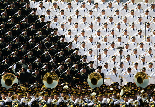 Military band sing and salute at the Tiananmen Square at the beginning of the military parade marking the 70th anniversary of the end of World War Two, in Beijing