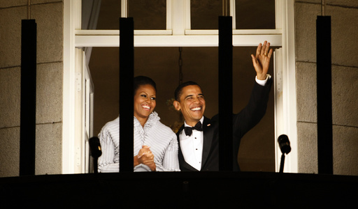 U.S. President Barack Obama and his wife Michelle wave from the balcony of the Grand Hotel in Oslo