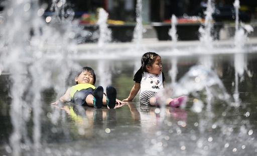 Children play in a fountain in South Korea