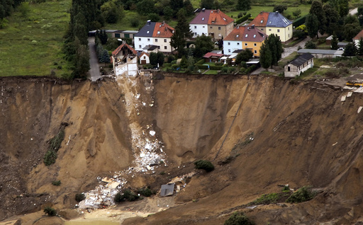 An aerial view shows the debris of a residential building and a destroyed road in the village of Nachterstedt